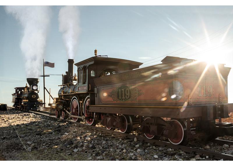Golden Spike engines meet in sunlight